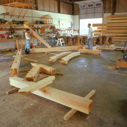 Timber frame parts staged in the LANCOTF workshop